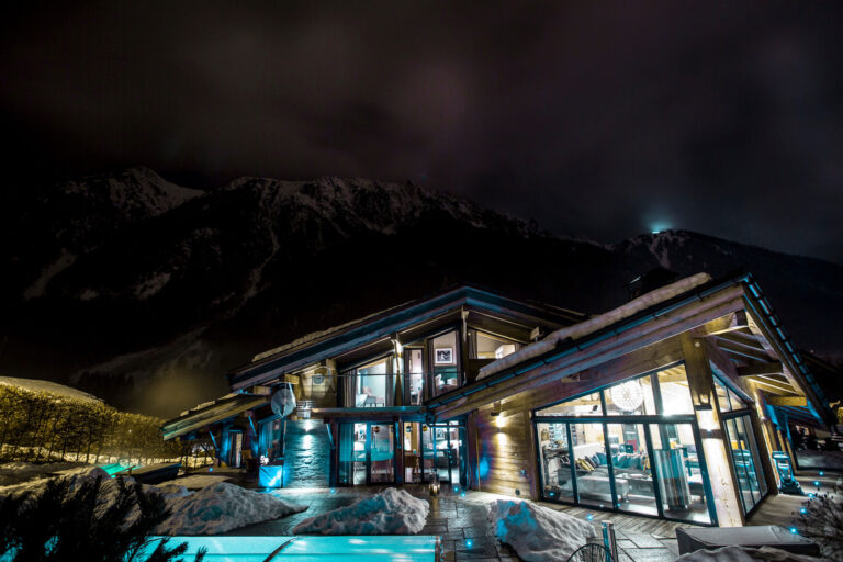 chalet couttet pool at night in winter